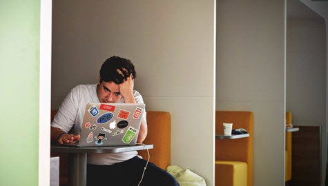 Frustrated man on laptop